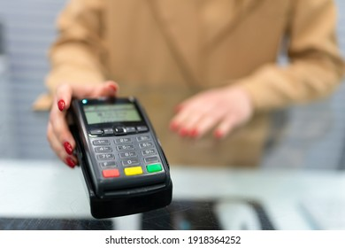 Woman gives payment terminal to client
