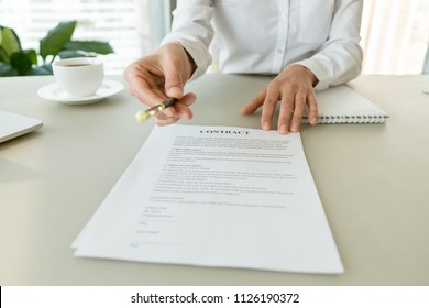 Woman gives pen offers to sign new job employment contract, partner promising good deal convincing to agree on terms of loan insurance put signature on legal business document concept, close up view