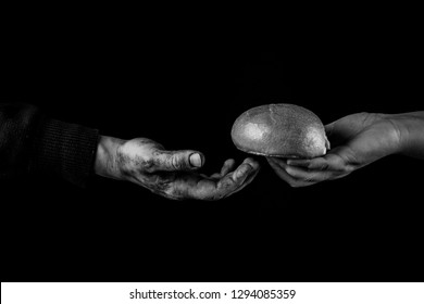 Woman giving Bread to a poor man. Helping Hand Concept. Black and white