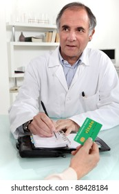 Woman giving a card to a doctor