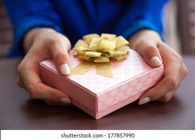 Woman giving gift box present