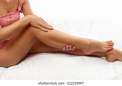 Woman giving her legs and feet good massage