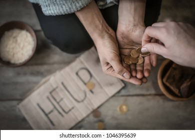 Woman giving money to poor female beggar, closeup