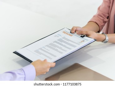 woman Giving resume to HR officer for job interview