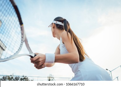 Woman giving return playing tennis on court