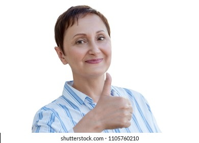 Woman giving thumbs up, the thumb sign of approval. Portrait of middle aged older woman 40 50 years old isolated on white background.