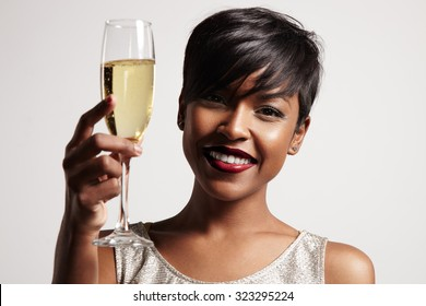 woman with a glass of champagne. Celebrating and smiling