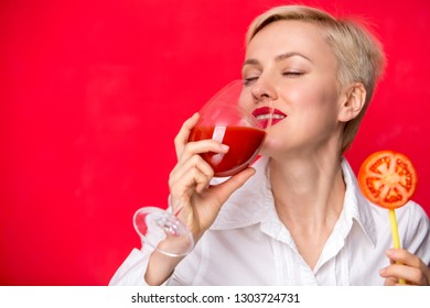 woman with a glass of red tomato juice. Healthy lifestyle concept