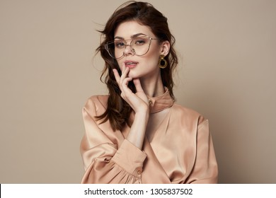 A woman with glasses a beautiful face Bright shirt
