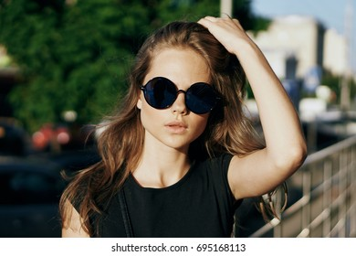 The woman in glasses corrects hair