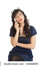 Woman in glasses emotionally speaks on a mobile phone