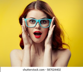 woman in glasses on a Orange background, a woman with glasses, woman...