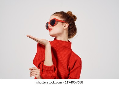 woman in glasses in the shape of a heart and a red sweater