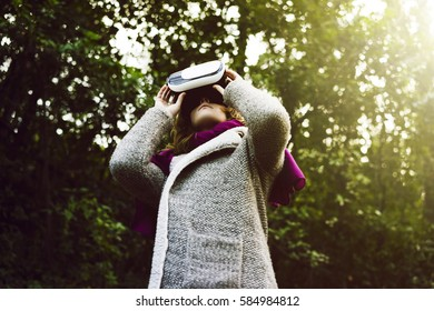 woman with glasses of virtual reality in nature