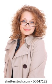 Woman with glasses wearing trenchcoat standing on white