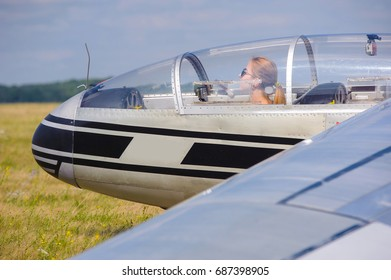 Woman in glider waiting for flight