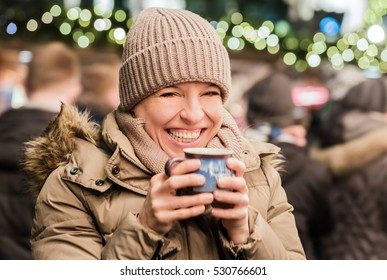 Woman with glogg at christmas market