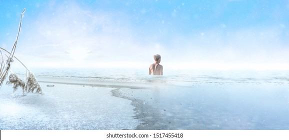Woman goes into a frozen lake for ice swimming in winter
