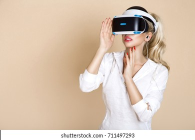 Woman with gogle glasses . Young girl in virtual augmented reality helmet. Headset. Future technology concept.