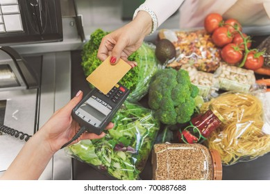 Woman going to make payment in supermarket