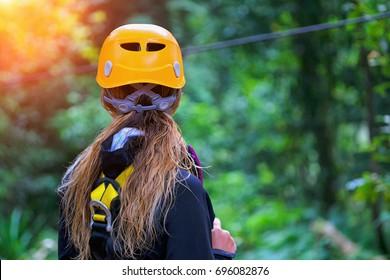 Woman going on a jungle zipline adventure