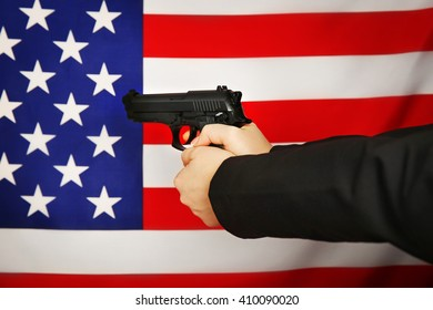 Woman is going to shoot on USA flag background