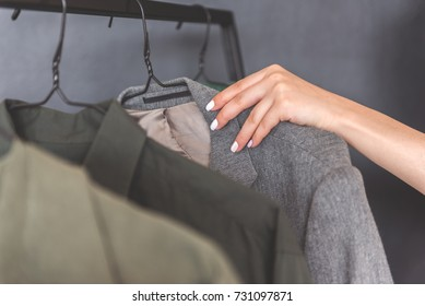 Woman going to take rack with coat