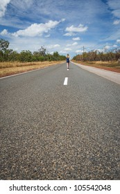 Woman is going through the road of outback, Outback Australia, Northern Territory