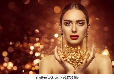 Woman Gold Beauty, Fashion Model Holding Golden Jewelry in Hands