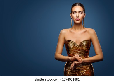 Woman Gold Dress, Fashion Model Sparkling Sequin Gown, Young Girl Beauty Portrait over Blue Background