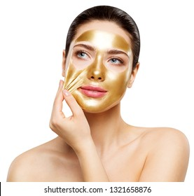 Woman Gold Mask, Beautiful Model Removing Golden Facial Skin Cosmetic, Beauty Skincare and Treatment