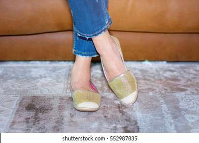 Woman in gold shoes. Elegant stylish shoes.