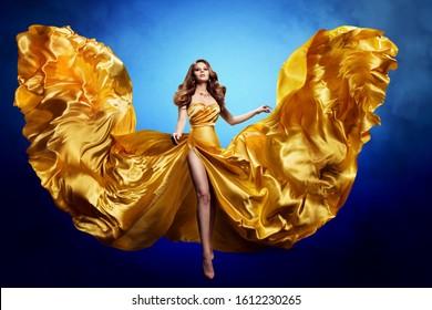 Woman Gold Silk Dress, Fashion Model Beauty, Blowing Waving Gown, Cloth Fluttering on Wind