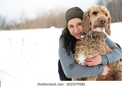 Woman with goldendoodle winter season