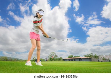 woman golf player concentrate in hit the golf ball away to the destination green for winning in score rate