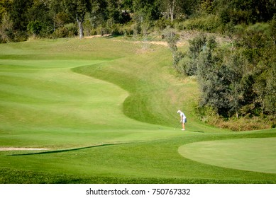 Woman golfer in Green landscape in golf club