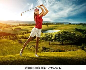 Woman golfer hitting the ball on the background scenery  beautiful