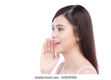 Woman gossip about other with hand near her ear