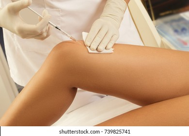 Woman got injection in knee. Concept of skin rejuvenation or joint pain treatment.