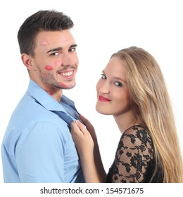 Woman grabbing a man with a lot of lipstick shapes isolated on a white background