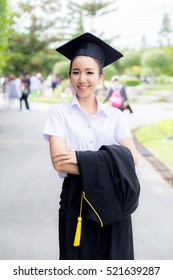 woman is a Graduate smiling for the camera with happy successful of education
