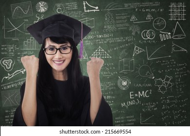 Woman in graduation gown expressing success in the class