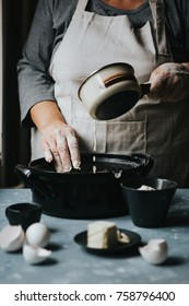 Woman grater margarine. Preparing dough