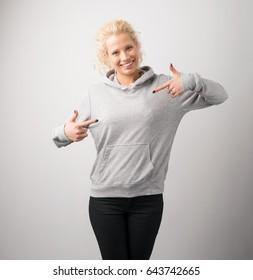 Woman in gray hoodie, mockup for logo or branding design