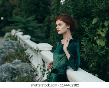 woman in green dress on nature fashion