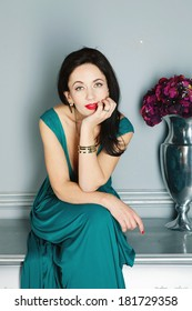 woman in green dress and red lipstick