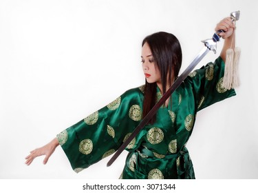 woman with a green kimono and chinese sword
