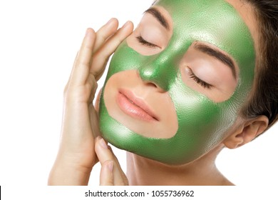 Woman with green peel-off mask on her face isolated on white background