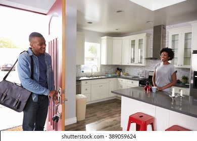 Woman Greeting Man Returning Home From Work