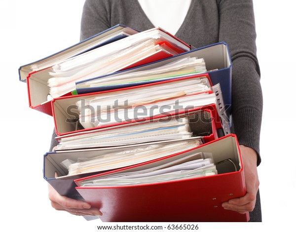 woman in grey holding stack of folders Pile with old documents and bills. Isolated on white background